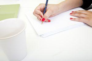 coaching platform - handing writing on paper